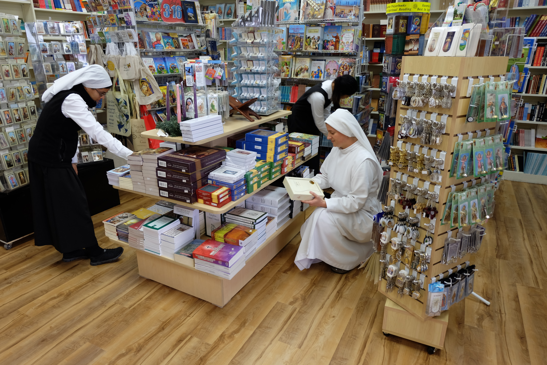 Reorganizing the newly renovated St. Joseph Bookstore