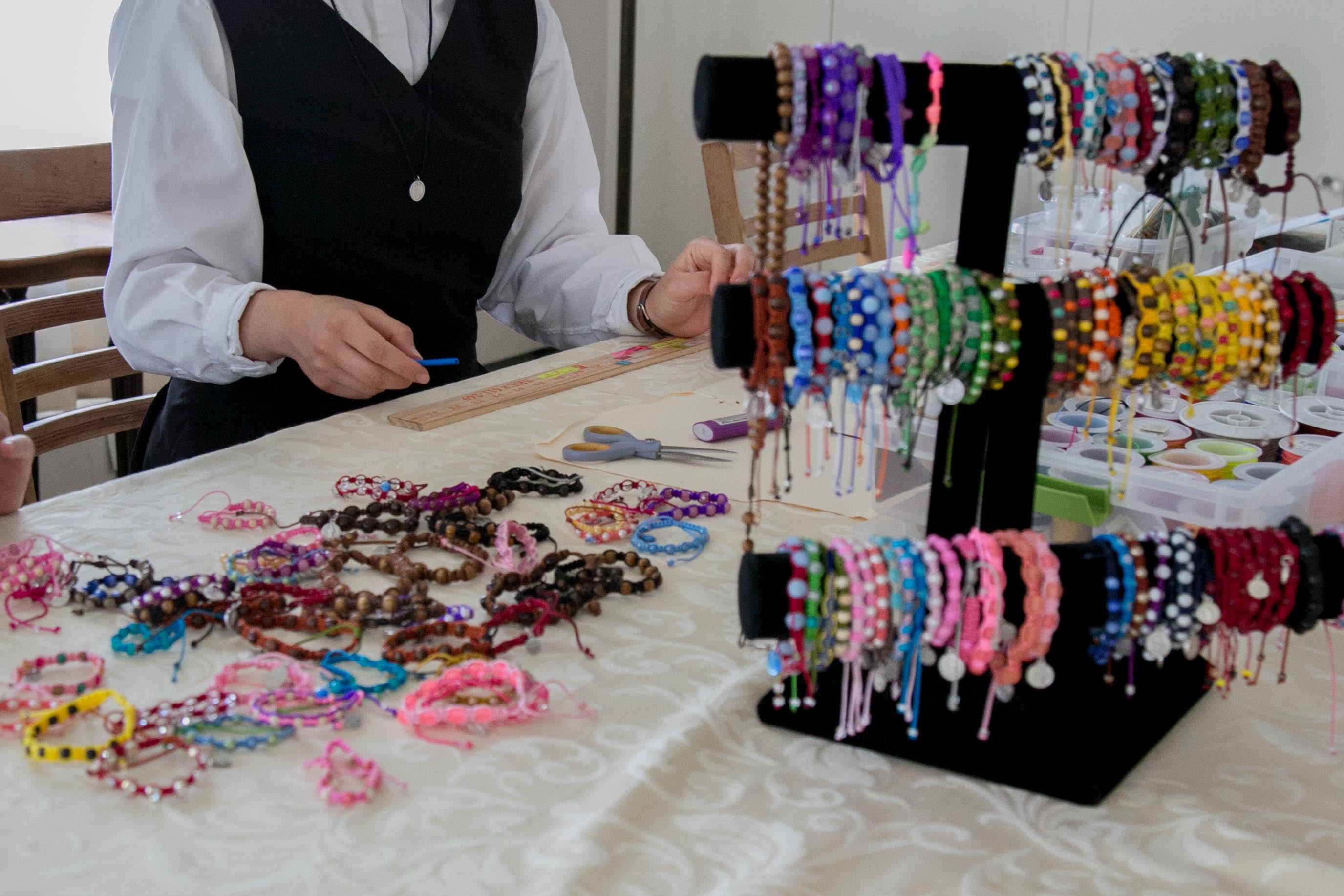 Making rosary bracelets to sell at the St. Joseph Bookstore